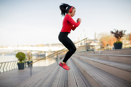Sporty young woman jumping outdoor Stock Photo