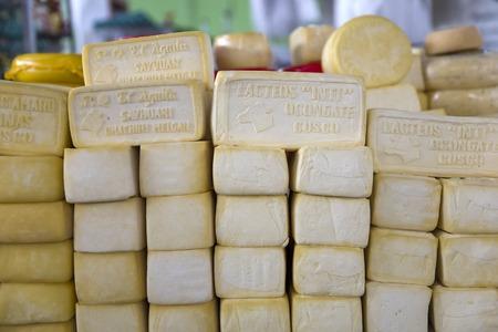 CUSCO, PERU - JANUARY 2, 2018: Local dairy products on the San Pedro market in Cusco, Peru. There are 720 dairy farms in Cusco, Puno and Cajamarca of Peruvian Sierra. Sajtókép