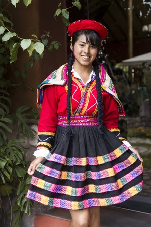 CUSCO, PERU - DECEMBER 31, 2017: Unidentified young woman on the street of Cusco, Peru. the Entire city of Cusco was designated a UNESCO World Heritage Site in 1983. 에디토리얼