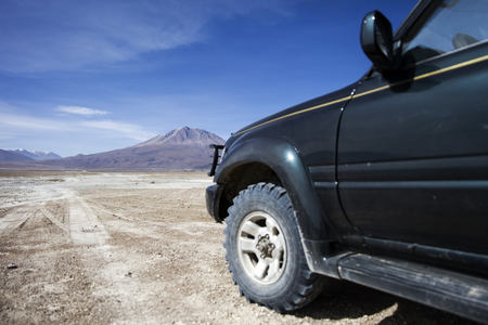Terrain vehicle at Dali desert at Eduardo Avaroa Andean Fauna National Reserve in Bolivia Stock Photo