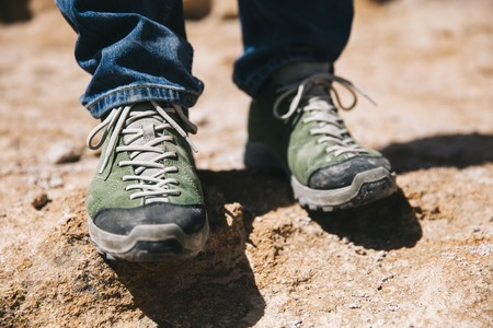Closeup of the hiker shoes on the mountain