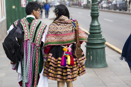 CUSCO, PERU - DECEMBER 31, 2017: Unidentified people on the street of Cusco, Peru.