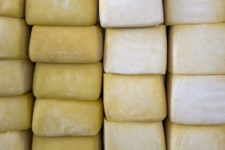 Close up view at pile of Peru cheese on the Cusco cheese market Фото со стока