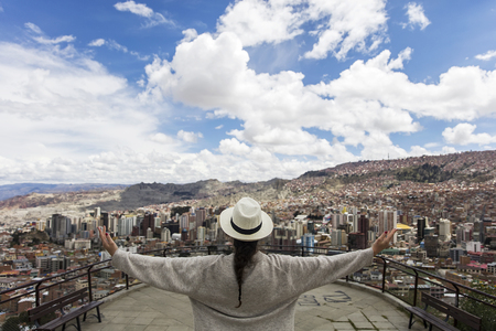 Young woman looking at the panorama of La Paz, Bolivia