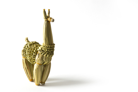 Corn husk llama figurine isolated on the white background