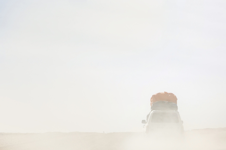 Terrain vehicle in Dali desert at Eduardo Avaroa Andean Fauna National Reserve in Bolivia Stock Photo