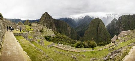 MACHU PICCHU, PERU, JANUARY 3, 2018: Unidentified people at remains of ancient Inca citadel in Machu Picchu, Peru. Almost 2500 tourists visit Machu Picchu every day. Editorial