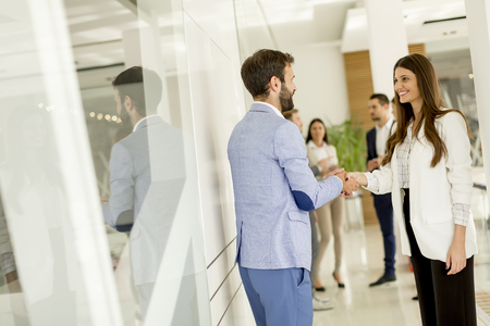 Young business people shaking hands in the office