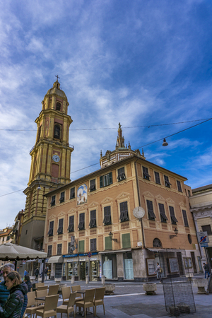 RAOPALLO, ITALY - MARCH 12, 2018: Unidentified people by basilica of San Gervasio e Protasio in Rapallo, Italy. italy, Basilica was consecrated in 1118 and restored in early 17th century