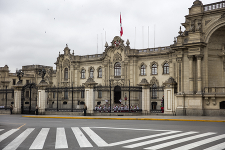 LIMA, PERU - DECEMBER 29, 2017: Changing of the guards by Presidential Palace in Lima, Peru. This Baroque Revival was opened in 1938.