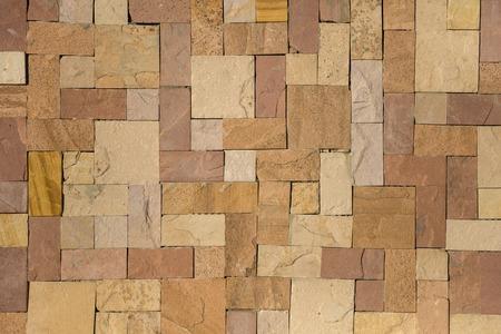 Steinwandbeschaffenheitshintergrund Standard-Bild
