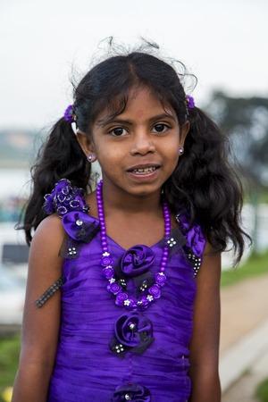 NUWARA ELIYA, SRI LANKA - JANUARY 25, 2014: Unidentified little girl on the street of Nuwara Eliya, Sri Lanka. In Nuwara Eliya live more than 43.000 people, mostly Sinhalese. 報道画像