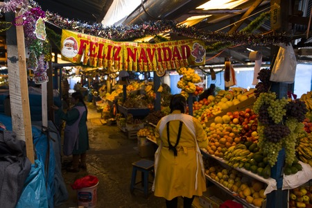 CUSCO, PERU - JANUARY 2, 2018: Unidentified people on the San Pedro Market in Cusco, Peru. Markets play very important part of todays culture in Peru.
