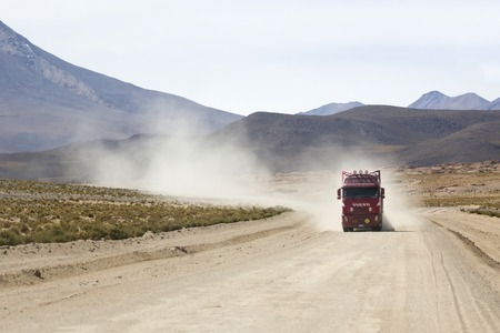 BOLIVIA - JANUARY 14, 2018: Truck on the unpaved road in Bolivia. At 2004 more than 92% of roads in Bolivia were unpaved. 報道画像