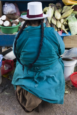 CUSCO, PERU - JANUARY 5, 2018: Unidentified woman on the San Pedro Market in Cusco, Peru. Markets play very important part of todays culture in Peru.