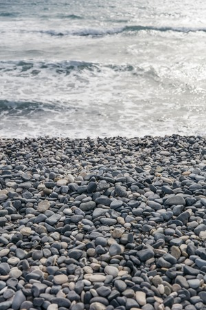 Detail of the cobble stone beach and sea