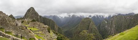 MACHU PICCHU, PERU, JANUARY 3, 2018: Unidentified people at remains of ancient Inca citadel in Machu Picchu, Peru. Almost 2500 tourists visit Machu Picchu every day. Redakční