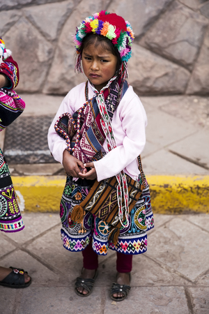CUSCO, PERU - DECEMBER 31, 2017: Unidentified girl on the street of Cusco, Peru. Almost 29% of Cusco population have less than 14 years. Editorial
