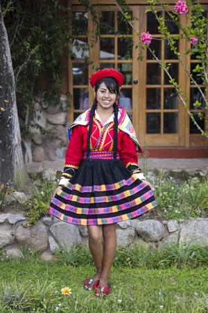 CUSCO, PERU - DECEMBER 31, 2017: Unidentified young woman on the street of Cusco, Peru. the Entire city of Cusco was designated a UNESCO World Heritage Site in 1983. Editorial