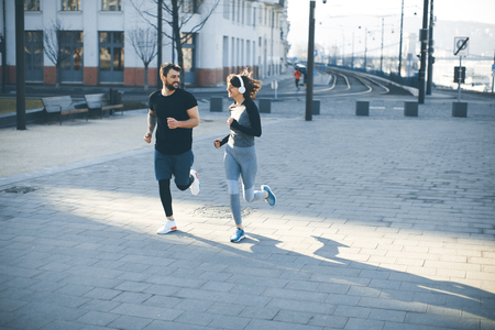 Young couple running  in the morning as a good habit