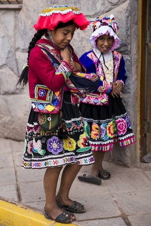 CUSCO, PERU - DECEMBER 31, 2017: Unidentified girls on the street of Cusco, Peru. Almost 29% of Cusco population have less than 14 years. Editorial