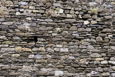 Close up view at old stone wall texture