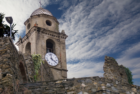 Clock tower in the village of Vernazza, Cinque Terre, Liguria, Italy