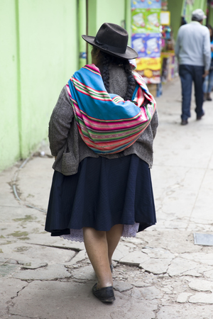 Unidentified woman on the street of Cusco, Peru.