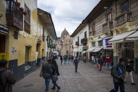 CUSCO, PERU - JANUARY 5, 2018: Unidentified people on the street of Cusco, Peru. the Entire city of Cusco was designated a UNESCO World Heritage Site in 1983.