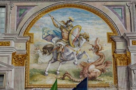 GENUA, ITALIEN - 9. MÄRZ 2018: Palazzo San Giorgio in Genua, Italien. Der Palast wurde 1260 erbaut und die Fassade wurde Ende des 19. Jahrhunderts erneuert
