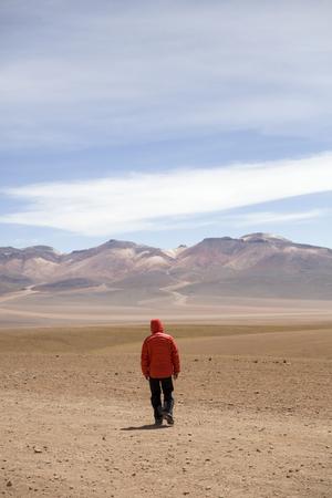 Young man at Dali desert at Eduardo Avaroa Andean Fauna National Reserve in Bolivia