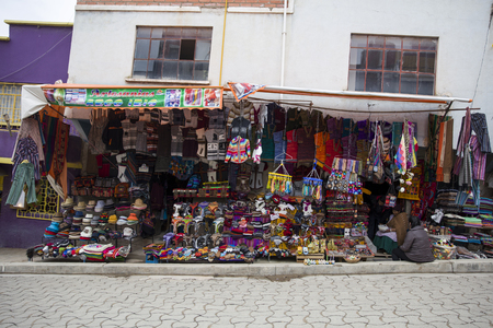 COPACABANA, BOLIVIA - JANUARY 9, 2018: Handcraft goods on the street of Copacabana, Bolivia. Copacabana is the main Bolivian town on the Lake Titicaca Редакционное