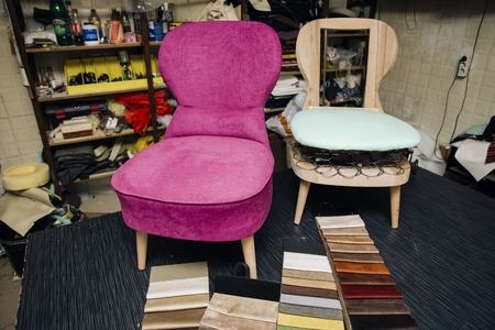 View at chair repairing in the upholstery workshop Standard-Bild
