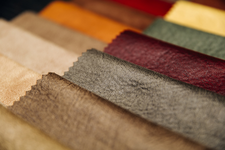 Closeup of the colorful furniture covers in the upholstery workshop