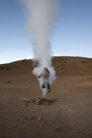 Young man at Geysers Sol de Manana at Eduardo Avaroa Andean Fauna National Reserve in Bolivia