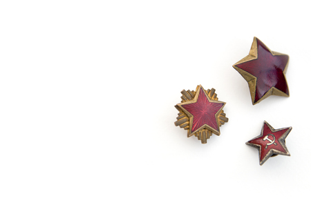 Old red stars from communist military caps isolated on the white background 스톡 콘텐츠 - 101821959