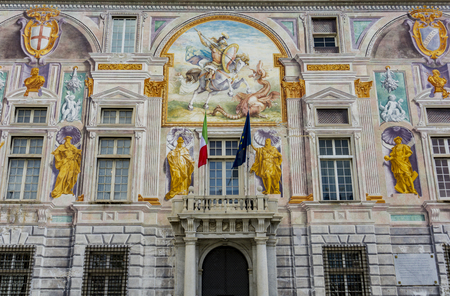 GENOA, ITALY - MARCH 9, 2018: Palazzo San Giorgio in Genoa, Italy. Palace was built in 1260 and facade was refrescoed in the late 19th century