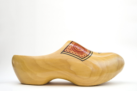 Traditional dutch wooden clog isolated on the white background 免版税图像