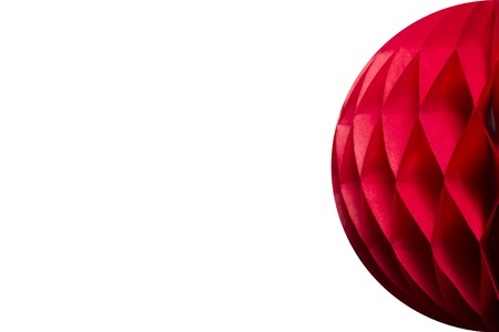 Red honeycomb pom-pom paper ball decoration isolated on white background