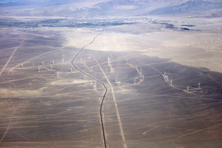 Aerial view at wind turbines in the countryside