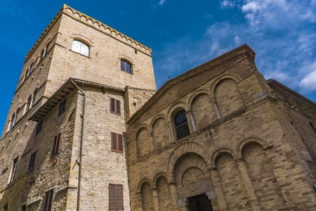 View at old church Chiesa San Bartolo in San Gimignano in Tuscany, Italy.