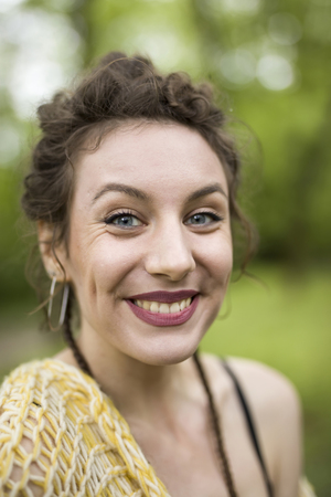 Portrait of young woman makes smile