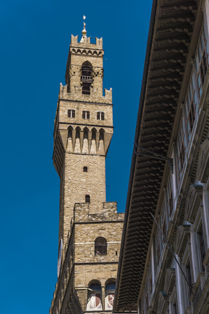Detail of tower of Palazzo Vecchio in Florence, Italy