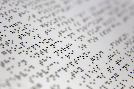 Braille alphabet signs on the white paper Stock Photo