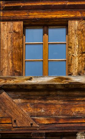 Closeup detail of the traditional Swiss chalet house Фото со стока