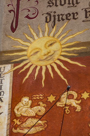 RIPPERSWIL, SWITZERLAND - MAY 18, 2018: Detail from sunclock of Ripperswil Rathaus in Switzerland. Rathaus is listed as Swiss object of national importance.