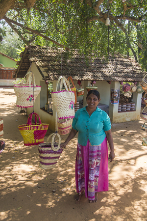 MATARA, SRI LANKA - JANUARY 25, 2014: Unindentified woman selling bags at Matara district in Sri Lanka. Matara is one of 25 districts of Sri Lanka with population of 800.000.