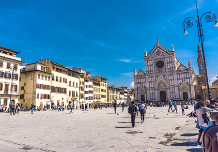FLORENCE, ITALY - APRIL 6, 2018: Unidentified people by Basilica of Santa Croce in Florence, Italy. It is the principal Franciscan church in Florence.