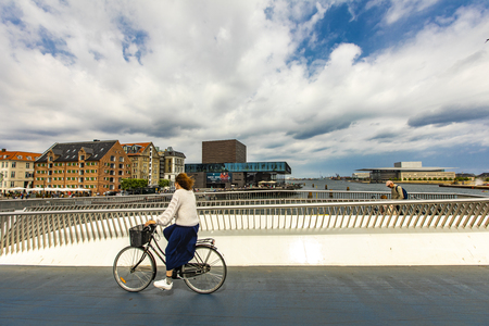 COPENHAGEN, DENMARK - JUNE 14, 2018: Unidentified people on Inderhavnsbroen bridge in Copenhagen, Denmark. It is combined pedestrian and bicyclist bridge opened at 2016. Editorial