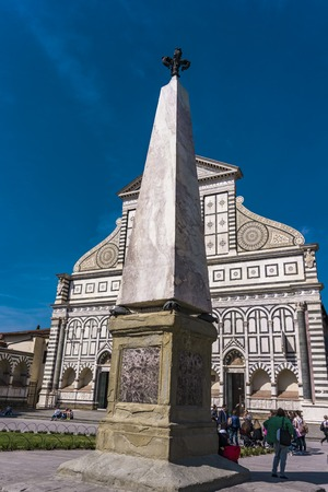 FLORENCE, ITALY - APRIL 6, 2018: Unidentified people by Basilica of Santa Maria Novella in Florence, Italy. It is an Dominican 15th century church. Editorial